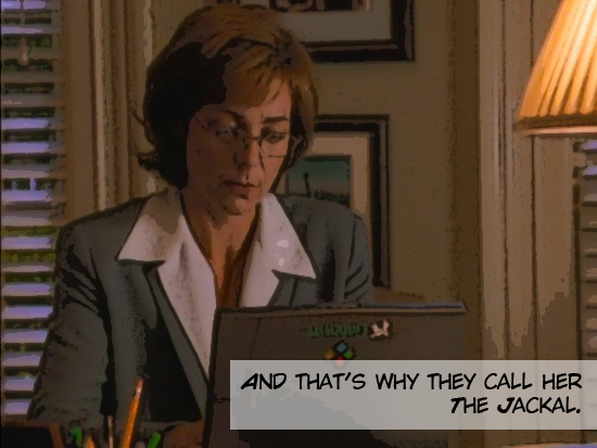 """Still from TV show """"The West Wing."""" A woman types away at her computer."""