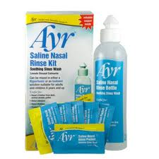 A bottle and set of saline packets for nasal irrigation