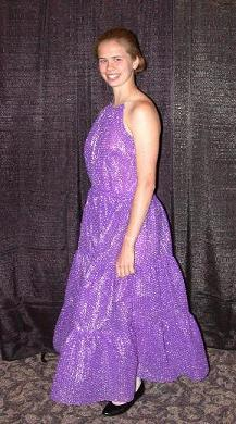 Young woman wearing a purple prom-style dress made out of bubble wrap