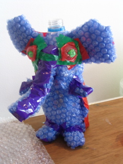 Purple and blue elephant made of bubble wrap