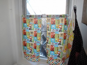 Completed curtains in window