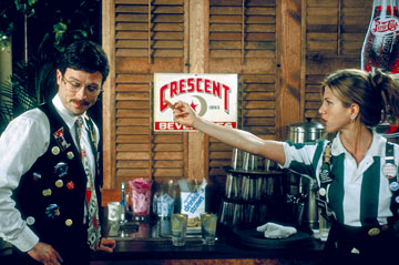 Still from the movie Office Space, showing Jennifer Anison in her role as a waitress flipping off her mean boss.