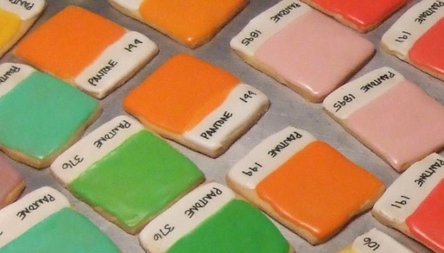 Iced sugar cookies made to look like Pantone color chips in pink, orange and green.