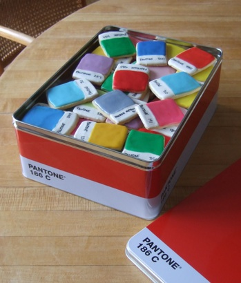 Iced sugar cookies made to look like Pantone color chips in a red Pantone branded tin.