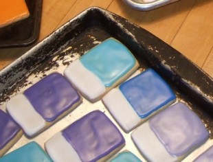 Iced sugar cookies made to look like Pantone color chips in metalic blue, purple and turquoise