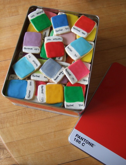 Iced sugar cookies made to look like Pantone color chips in a red Pantone themed tin.