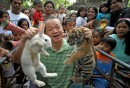 Zoo owner displaying bunny and tiger cub