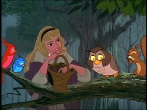 A still from the Disney version of Sleeping Beauty shows the princess in the woods, resting her arms on a branch, surrounded by birds.