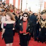 Drew Barrymore escorted by Corey Feldman