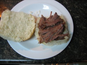 partially assembled sandwich with beef