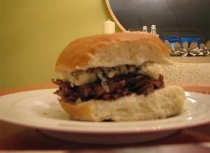 Completed pulled beef, caramelized onion, and gorgonzola sandwich