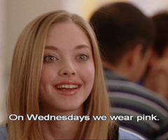 "Amanda Seyfriend in Mean Girls. She is smiling and the text reads ""On Wednesdays we wear pink"""