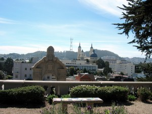 San Francisco in the spring.  Spanish-style buildings with mountains in the background.