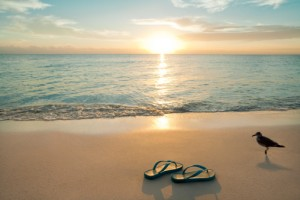 Sunrise On Flip-Flops At The Beach
