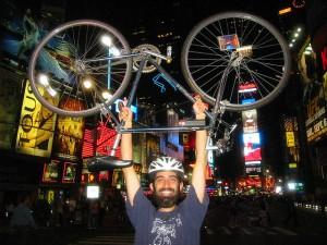 Daniel Kahn Gillmor doing a bikelift in the middle of the street in Times Square. Critical Mass, August 2008. NYC