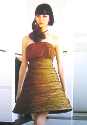Brittani models a dress.