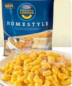 Bowl of macaroni and cheese with the Kraft Homestyle Macaroni and Cheese package in the background