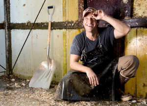 Mike Rowe in a barn for an episode of Dirty Jobs