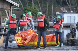 The Community gang go rafting in St. Patrick's Day hats