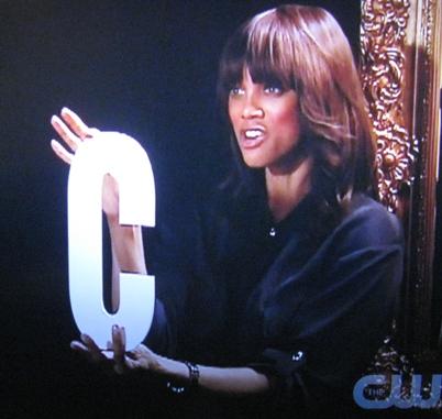 """Tyra Banks holds up a big """"C"""""""