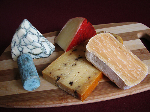 a photo of several different types of cheese on a cutting board by kraskland at flickr