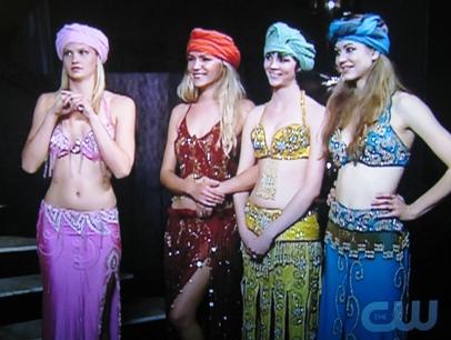 Molly, Hannah, Alexandria, and Brittani prepare to balance tea trays on their heads