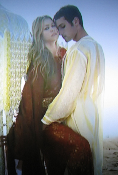 A beautiful malemodel poses with Hannah on America's Next Top Model in Marrakesh Morocco.