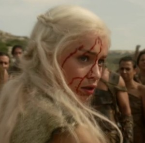 Close up of Dany, her face covered in blood