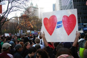 Sign demonstrating love equals love at equal marriage rally.