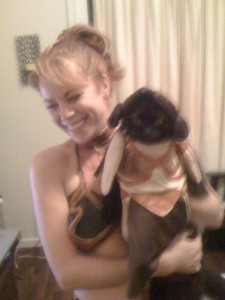 Woman and cat both dresses in Princess Leia's slave girl costume. The woman is laughing. The cat, not so much.