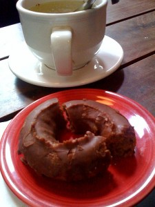 Vegan donut and cup of coffee.