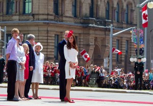 Prince William and Catherine in front of Canadian flags
