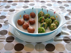 A divided try with a selection of peanut butter balls on the left and green balls on the right.