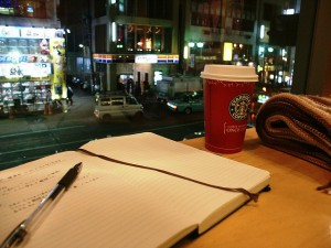 Moleskine notebook and Starbucks coffee