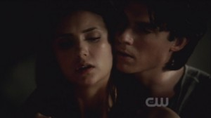Damon sexily teaching Elena how to stake a vamp.