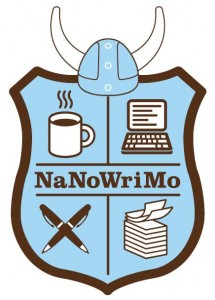 "NaNoWriMo Shield: Badge with a coffee cup, laptop, pens, and papers, topped with a horned ""Viking"" helmet"