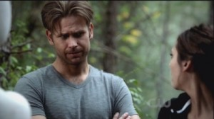 Alaric frowning at Elena's woeful punching.