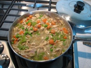 Filling for turkey pot pie simmering in a pan.