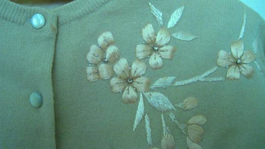A close up of the 1950s vintage sea foam green and rhinestone cardigan (from my collection).
