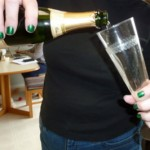 Closeup of pouring glass of champagne