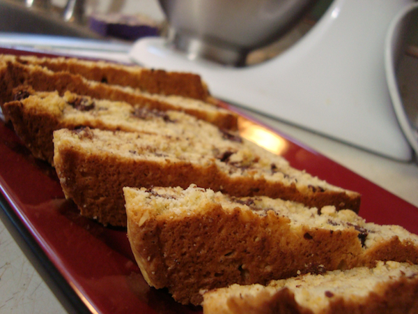 a macro picture of six pieces of biscotti on a rectangular shaped red plate