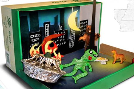 Shoebox diorama featuring a monster, a bear and a flaming spaceship.