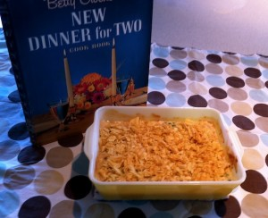 The Tuna and Chips Casserole is in a casserole dish next the cookbook.