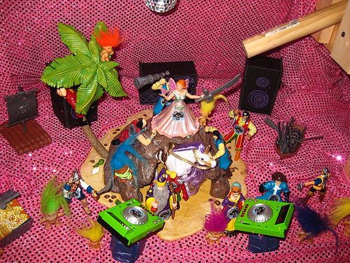 Diorama of a sparkly unicorn being ridden by a princess and surrounded by glitter.