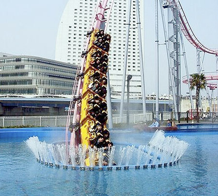 A roller coaster full of people disappears into an underwater tunnel
