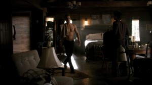 Shirtless Stefan prances through his bedroom as Damon holds some shirts