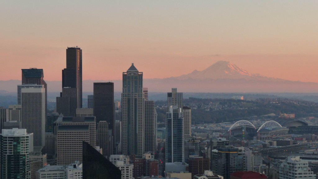 Sunset over Seattle with Mount Rainier illuminated in the distance.