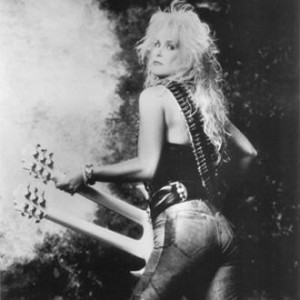 balck and white picture of Lita ford and a guitar