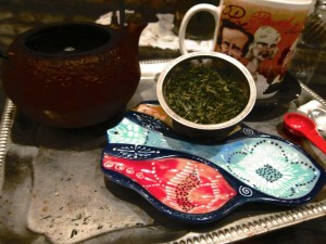 used tea in strainer has been pulled from the teapot