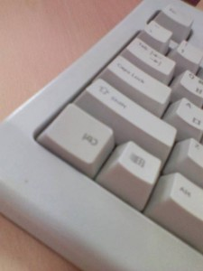 A keyboard with an upside down key.